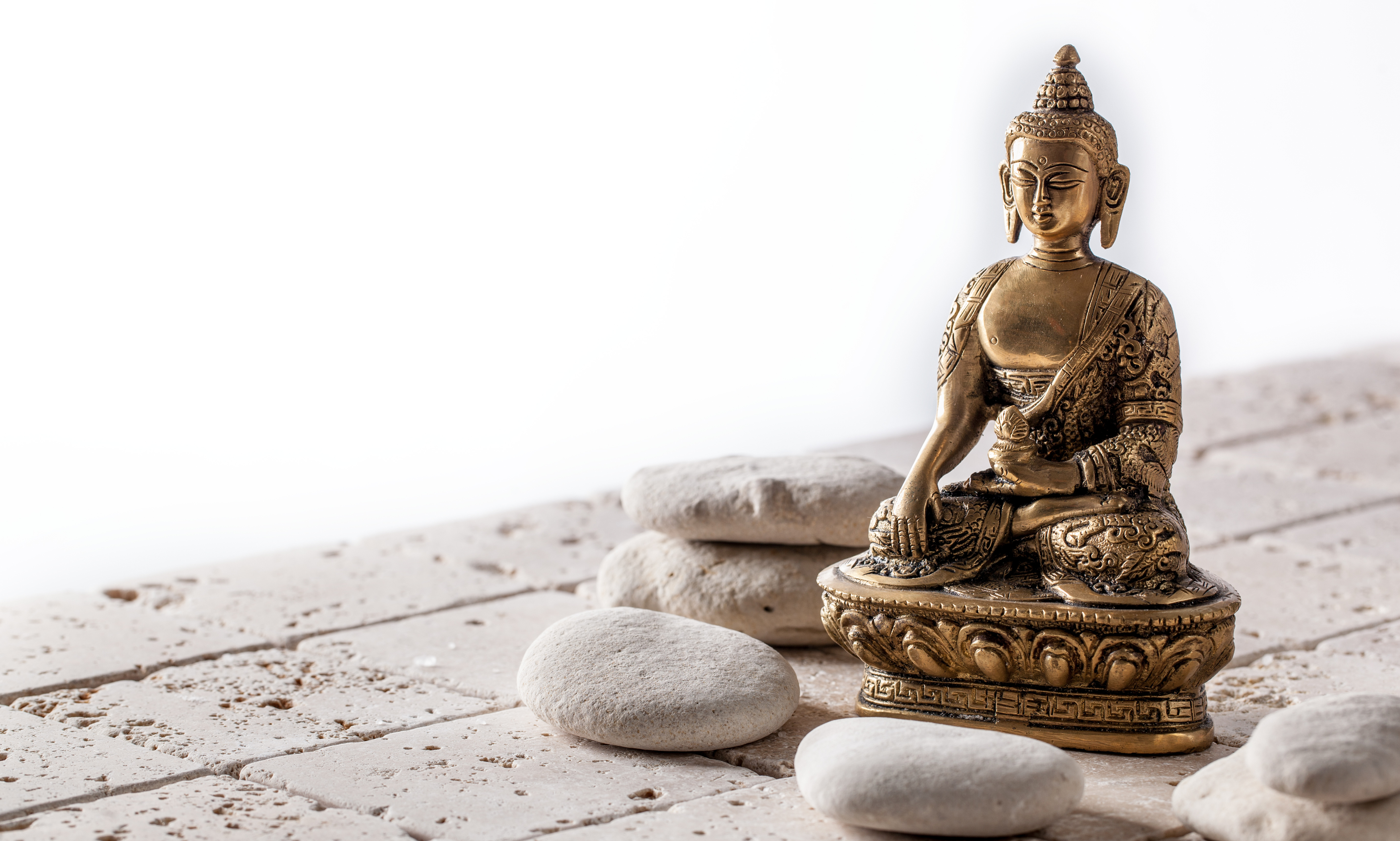 Buddhism and mindfulness symbol for meditation and wellbeing over pure pebbles and clean limestone, copy space